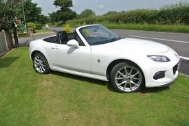 Fantastic looking Mazda MX5, still with 12 months warranty, white body with black hood