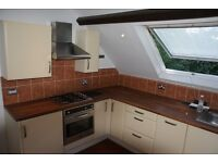 2 bed attic flat with roof terrace and parking overlooking quiet park
