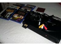 ps2 console and games.