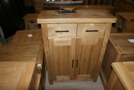 Derwent Oak 2 door, 2 drawer cabinet with 2 shelves 84cm wide.