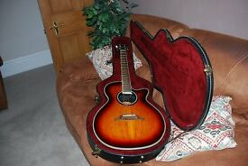 Crafter FX550EQ/P Electro Acoustic Guitar with a hard case.