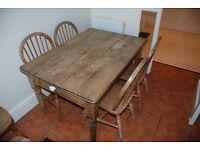 Wooden table with four matching chairs