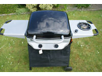 SAHARA TWIN BURNER GAS BBQ WITH ROASTING HOOD, SIDE BURNER & SHELF - USED TWICE