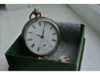 Silver pocket watch and chain