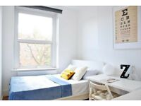 Bright room with standalone wardrobe in 5-bedroom flat, Camden