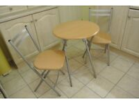 Folding kitchen/dining table and 2 chairs.