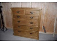 A large quality vintage pine chest of drawers