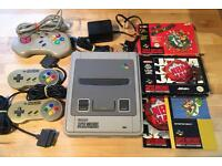 Super Nintendo (SNES) with 2 x boxed games and 3 controllers