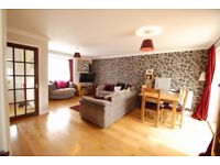A modern two bedroom house is presented in excellent condition with an attractive garden