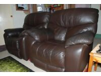 Pair of quality brown leather armchairs