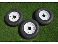 "Three 8"" trailer wheels"