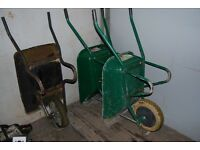 Three wheelbarrows with puncture proof wheels