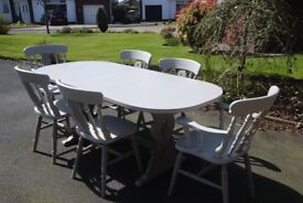 A unique hand painted extendable Dining Table and 6 Chairs. A Quality item in two tone grey. Bargain