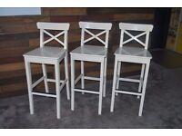 Three White Bar Stools