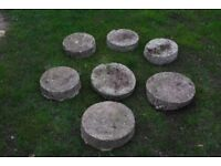 Seven circular(ish!) concrete stepping stones. Diameters from about 25cm - 30cm, depths about 7-8cm.