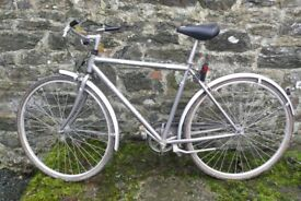 Traditional gent's Raleigh bike with single gear.