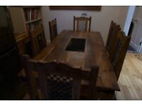 Large solid wood (Sheesham/Indian Rosewood) dinning table with 6 chairs.