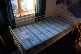 Single metal framed bed and mattress