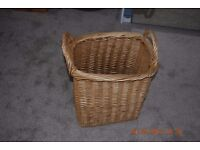 Large basket with handles possibly for laundry?