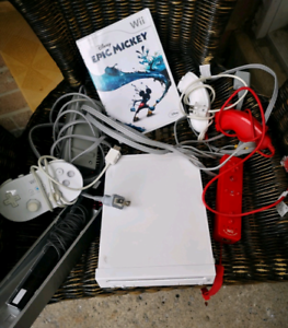 Nintendo Wii with controllers and Epic Mickey game