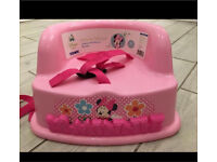 Pink Minnie Mouse booster seat