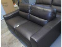 A brand new dark brown leather effect 2 seated sofa.