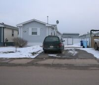 NEWLY REDUCED!!! 2002 mobile with garage pad in Timberlea!