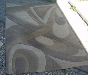 Area rug, abstract pattern beige & browns. Near Chinook