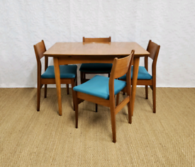 Vintage mid century teak extending dining table and chairs teal velvet