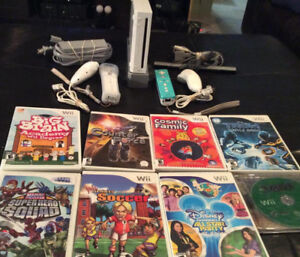 Nintendo Wii With 2 Controllers/2Nunchucks and 8 Games
