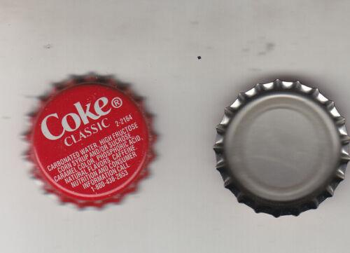 COKE CLASSIC  BOTTLE CAPS..100 PIECES  PLASTIC LINED UNUSED NEVER CRIMPED