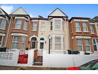 A furnished four bedroom house with two receptions and private garden close to Seven Sisters Station