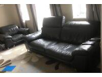 Grey/black leather sofa/ recline