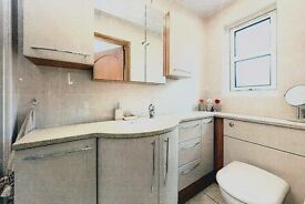 L-shaped bathroom units incorporating basin and WC.
