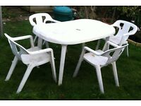 White plastic garden table and chair