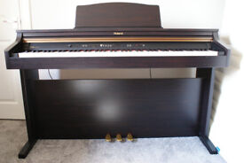 Roland HP102e Digital Piano.