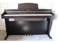 Roland HP102e Digital Piano.