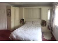 Cream bedroom suite to sell complete or separately. Incl. overbed units, robes, drawers + dresser.