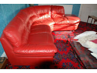 Red leather corner sofa with open end