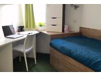 Single bed in 13 rooms student hall at Fieldgate Street in London