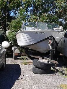 20 ft aluminum inboard boat and trailer as is