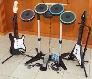 PS2/PS3 Rock Band drum set, microphone and 2 guitars