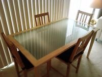 IKEA Table with Glass Top plus 6 Chairs & Seat Pads
