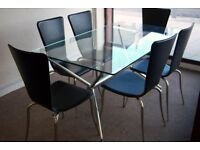 Rectangular Glass Top Table and Six black leather look Chairs with silver legs