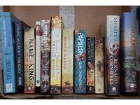 12 x Fiction Books. Mostly Historical Type Novels. Sharpe etc
