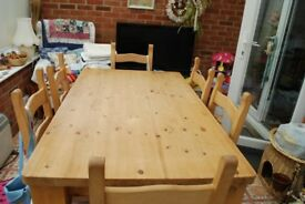 Solid wood dining table and 6 matching solid wood chairs.