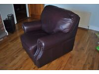 2 Brown leather armchairs (1 of them is a Lazy Boy)