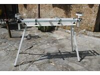 Mitre saw stand. Folding legs and extending stock rollers. Will suit most saws