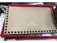 Valentino cream leather clutch bag