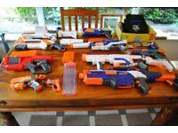 NERF GUN COLLECTION - 10 GUNS PLUS BULLETS & JACKET